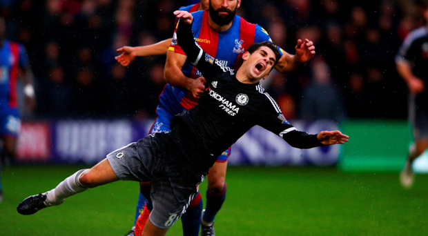 Taken down: Chelsea ace Oscar is fouled by Palace's Mile Jedinak