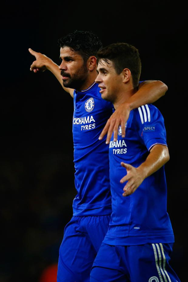 Clash: Diego Costa in happier times with team-mate Oscar
