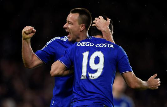 Get in: John Terry celebrates with Chelsea goalscorer Diego Costa