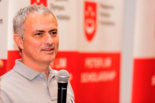 Biding his time: Jose Mourinho, pictured during a visit to Singapore yesterday, won't rush back into management