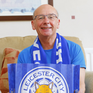 Special triumph: John Hill, who has supported Leicester for 50 years, celebrated the astonishing title success with son Paul in Manchester