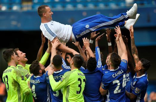 Captain marvel: John Terry is lifted by his Chelsea team mates after the draw with Leicester