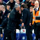 Man United boss Jose Mourinho and Blues manager Antonio Conte have words at the end