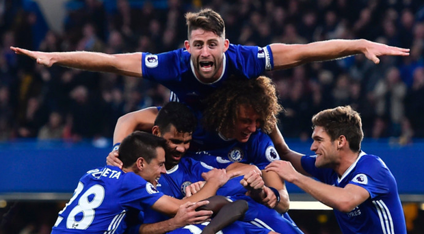 Flying high: Chelsea celebrate their win over Manchester United at Stamford Bridge