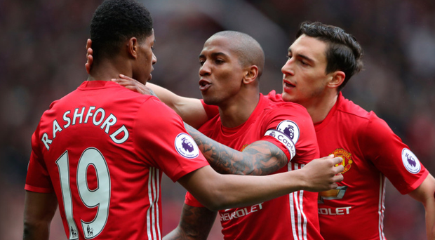 Breakthrough: Ashley Young and Matteo Darmian congratulate United's opening scorer Marcus Rashford