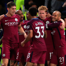 In form: Kevin de Bruyne celebrates with his Manchester City teammates after scoring the winner at Chelsea on Saturday