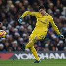Winning way: Thibaut Courtois clears his lines against Southampton as Marco Gabbiadini closes in