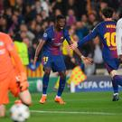 Two good: Ousmane Dembele celebrates with Lionel Messi after blasting Barcelona 2-0 in front