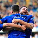 Winning form: Eden Hazard and Olivier Giroud celebrate