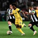 Catch me: Willian evades PAOK's Dimitrios Pelkas and Vieirinha