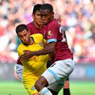 Three's a crowd: Eden Hazard is mobbed by West Ham duo Fabián Balbuena and Issa Diop