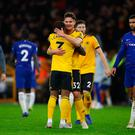 Job done: Ivan Cavaleiro is embraced by Leander Dendoncker after Wolves' victory