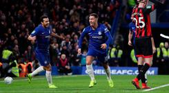 Sticking out: Eden Hazard wheels away after hitting Chelsea's late winner last night