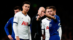 Deplorable scenes: Referee Anthony Taylor and Chelsea captain Cesar Azpilicueta point to the area of the ground where Antonio Rudiger alleges he was racially abused with monkey gestures