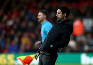 Mikel Arteta watches on as his new Arsenal side are held to a 1-1 draw at Bournemouth on Boxing Day. Former Gunners player Arteta was unveiled as the club's new manager following the sacking of Unai Emery. In March, his positive test for coronavirus was a major catalyst for the suspension of the Premier League (Mark Kerton/PA)