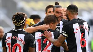 Newcastle's Dwight Gayle receives the congratulations of his team-mates after opening the scoring against Aston Villa (Laurence Griffiths/NMC Pool/PA)