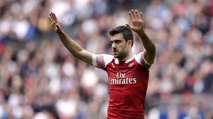Sokratis Papastathopoulos believes Arsenal can still finish in the top four (John Walton/PA)