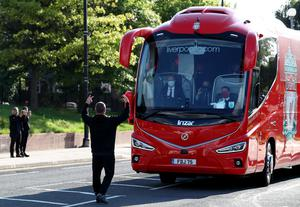 A fan gestures towards the Liverpool team coach outside the Etihad Stadium as the new Premier League champions arrived (Peter Byrne/PA)