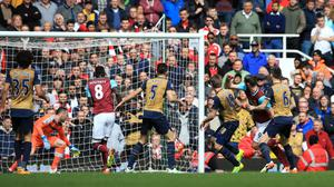 Andy Carroll, second right, grabbed an eight-minute hat-trick against Arsenal
