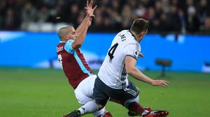 Sofiane Feghouli, left, was shown red for his challenge on Phil Jones