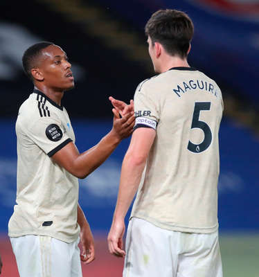 Harry Maguire congratulates Anthony Martial who grabbed the second