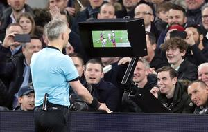 Referee Bjorn Kuipers checked with VAR before awarding Manchester City a penalty against Spurs (Adam Davy/PA)