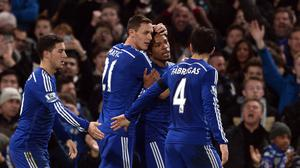 Chelsea's Loic Remy celebrates (second right) scoring the his side's third goal against Tottenham during the Barclays Premier League match at Stamford Bridge, London.