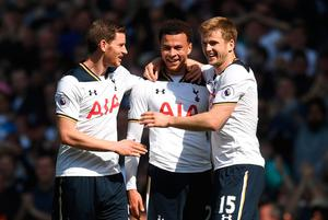 Delight: Dele Alli is congratulated by Jan Vertonghen and Eric Dier