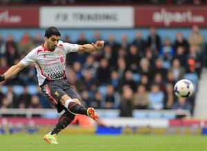 Robbie Fowler admits he has been very impressed with the performances of Luis Suarez