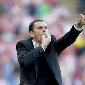 Head coach Gus Poyet, pictured, remains convinced Sunderland can avoid the drop