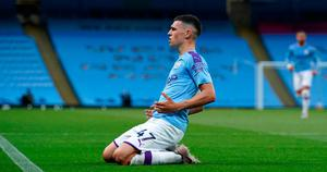 City slicker: Manchester City ace Phil Foden celebrates scoring against Liverpool