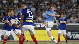 Kevin de Bruyne goes for goal against Yokohama F Marinos (Shuji Kajiyama/AP)