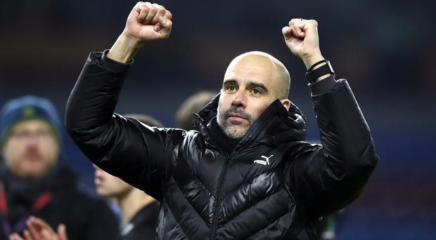 Pep Guardiola is the quickest manager to reach 100 Premier League wins (Martin Rickett/PA)