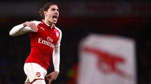 Hector Bellerin celebrates after scoring Arsenal's late equaliser