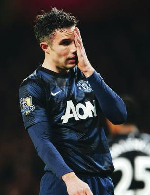Robin van Persie of Manchester United reacts during the Barclays Premier League match between Arsenal and Manchester United at the Emirates Stadium