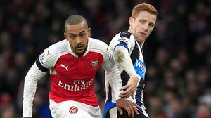 Theo Walcott, left, says Arsenal's players have the belief to win the Barclays Premier League