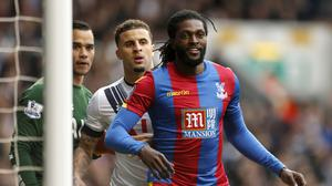 Emmanuel Adebayor, right, and Connor Wickham will most likely share the duties of leading Crystal Palace's line against Arsenal