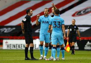 Tottenham's Harry Kane and Eric Dier speak with match referee Chris Kavanagh at half-time (Jason Cairnduff/NMC Pool/PA)
