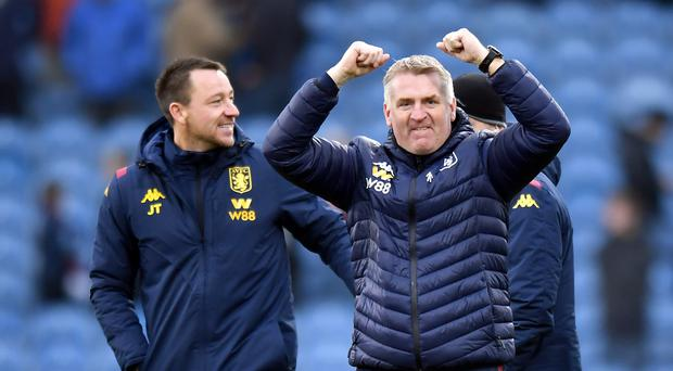 Dean Smith, right, celebrates Villa's victory at Turf Moor (Anthony Devlin/PA)