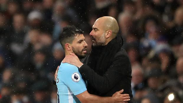Pep Guardiola, right, does not expect Sergio Aguero to be leaving Manchester City this summer