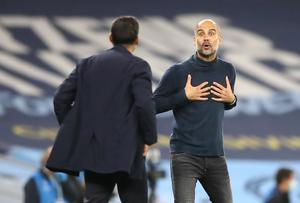 Guardiola (right) exchanged words Porto manager Sergio Conceicao during a fiery game in Manchester in October (Martin Rickett/PA)