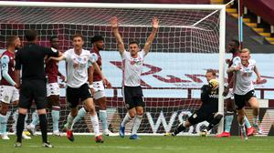 Sheffield United players appeal after Aston Villa goalkeeper Orjan Nyland carries the ball across the line. (Carl Recine/NMC Pool/PA)