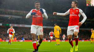 Alex Iwobi (left) grabbed his second Premier League goal of the season in Sunday's win over Crystal Palace.