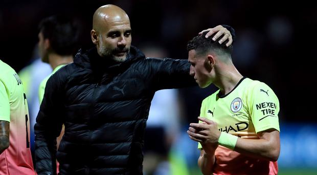 Pep Guardiola (left) is urging youngsters such as Phil Foden to be patient (Richard Sellers/PA)