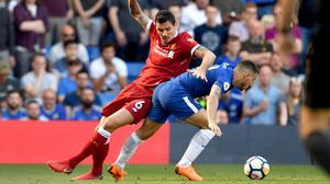 Liverpool's Dejan Lovren (left) and Chelsea's Eden Hazard battle for the ball during the Premier League match at Stamford Bridge, London.