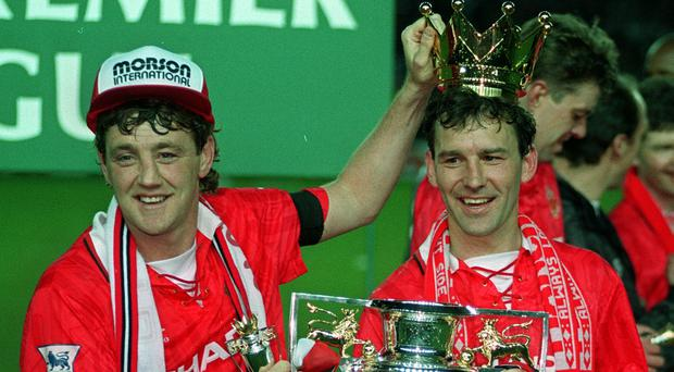 Then Manchester United captain Steve Bruce (left) and Bryan Robson with the Premier League Trophy (Malcolm Croft/PA)