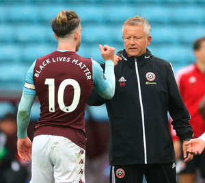 Spoils shared: Chris Wilder with Villa ace Jack Grealish after the game