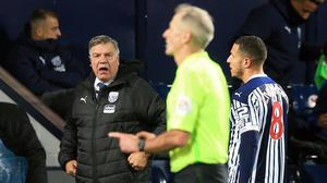 Sam Allardyce, left, shows his frustration after Jake Livermore, right, is sent off (Lindsey Parnaby/PA)