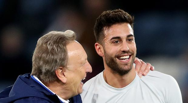 Cardiff manager Neil Warnock and Victor Camarasa celebrate the win at Leicester. (Nick Potts/PA)