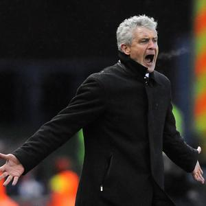 Mark Hughes, pictured, is interested in bringing Wolfsburg striker Ivica Olic to Stoke
